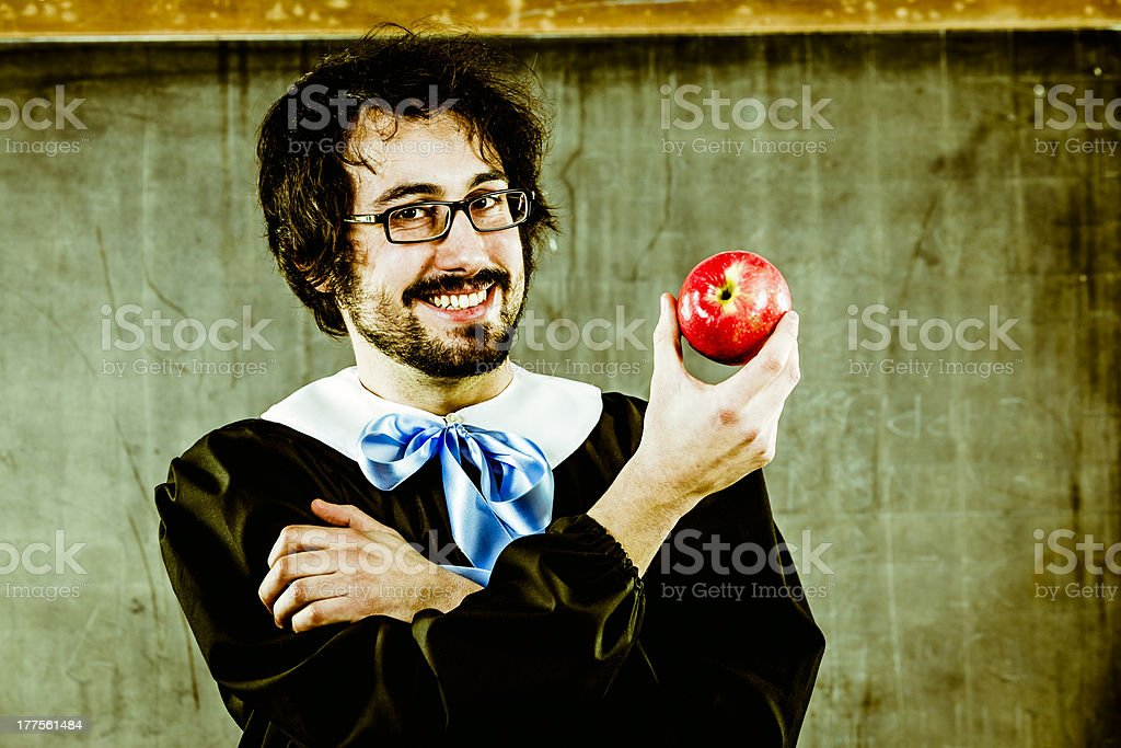 Adult Schholboy Holding an Apple. Back to School stock photo