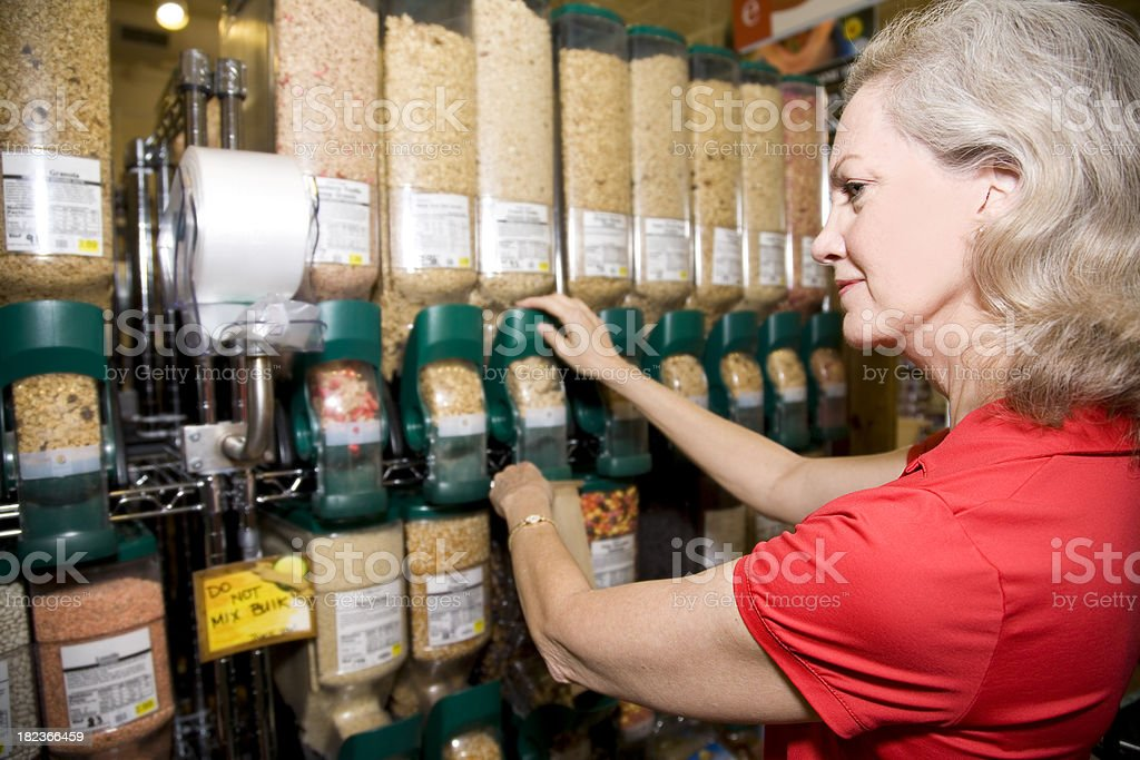 Adult Shopper Buying Grains and Cereal at the Grocery Store royalty-free stock photo
