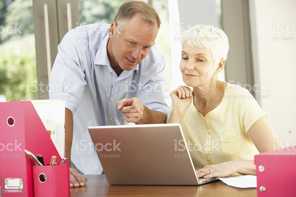Adult Son And Senior Mother Using Laptop At Home royalty-free stock photo