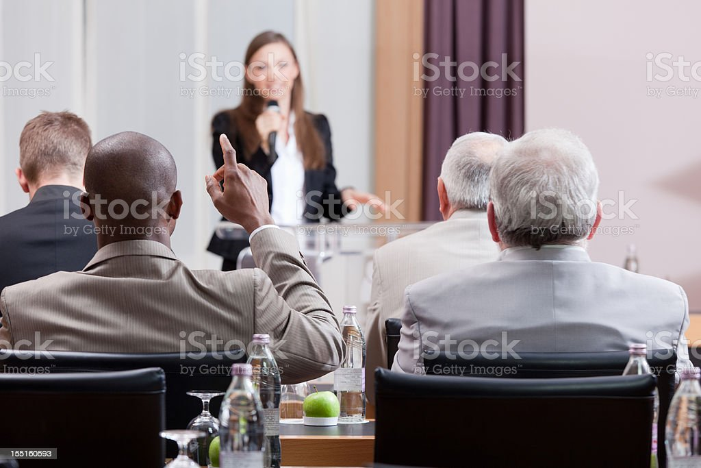Adult student asking a female lecturer a question royalty-free stock photo