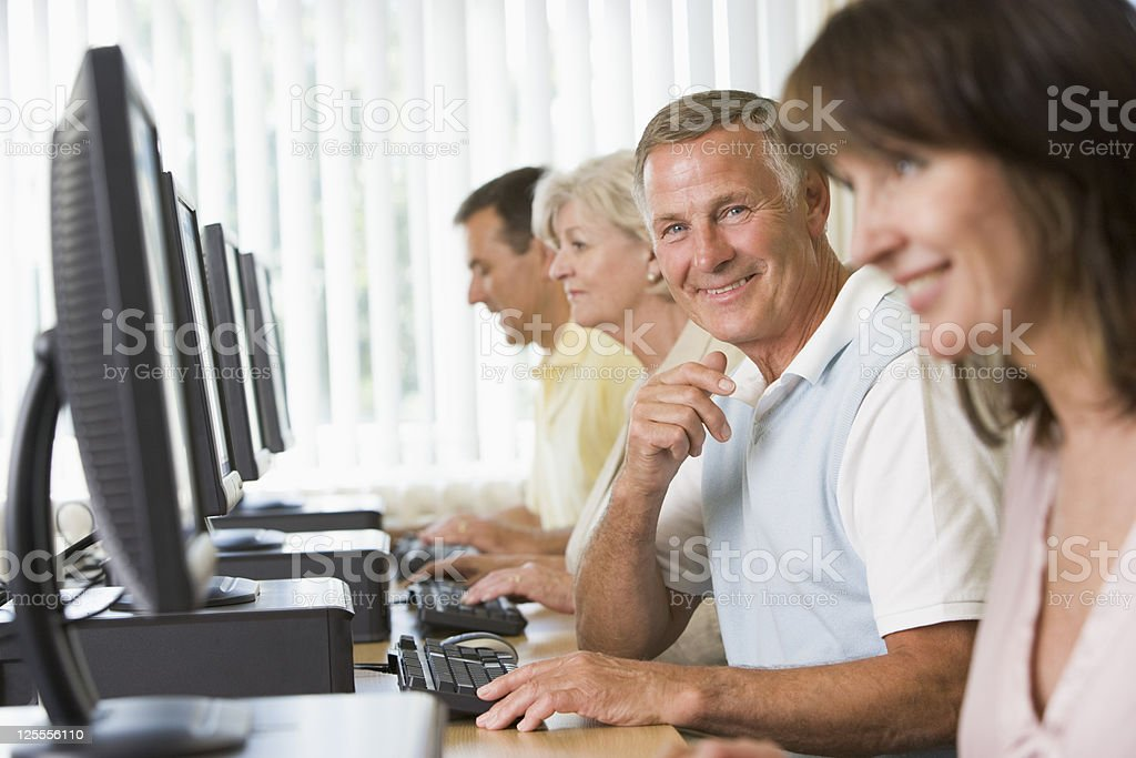 Adult students in a computer lab stock photo