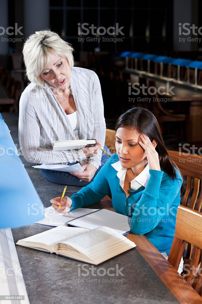 Adult students studying in library royalty-free stock photo