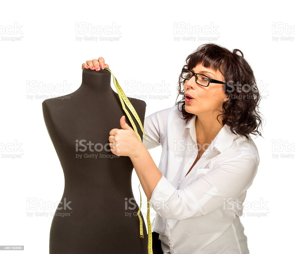 Adult tailor with mannequin stock photo