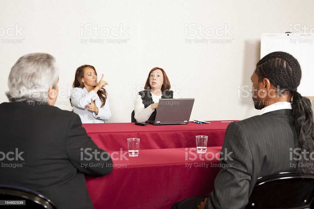 Adult training or seminar event with interpreter stock photo