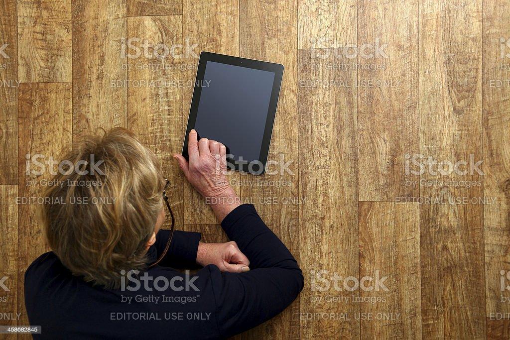 Adult using iPad digital tablet royalty-free stock photo