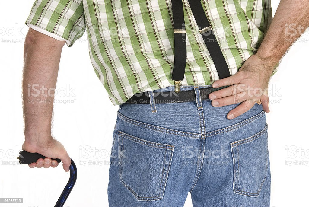 Adult walking with a cane stock photo