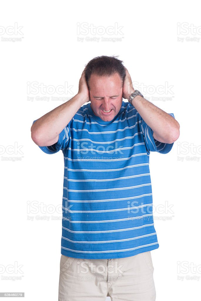 adult white man covering his ears and screaming stock photo