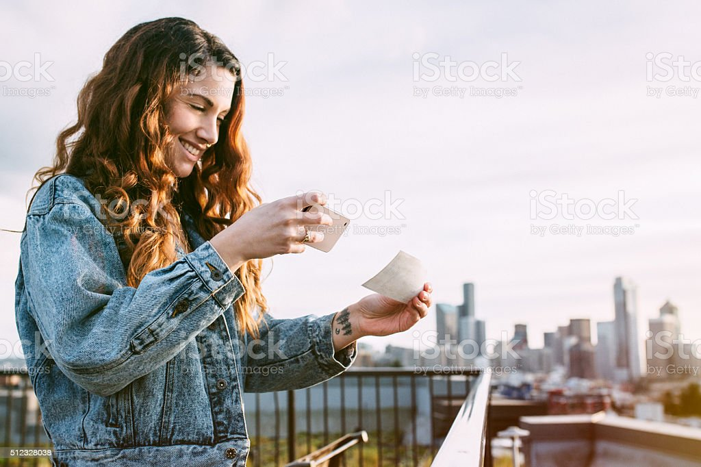 Adult Woman Depositing Check with Smart Phone stock photo
