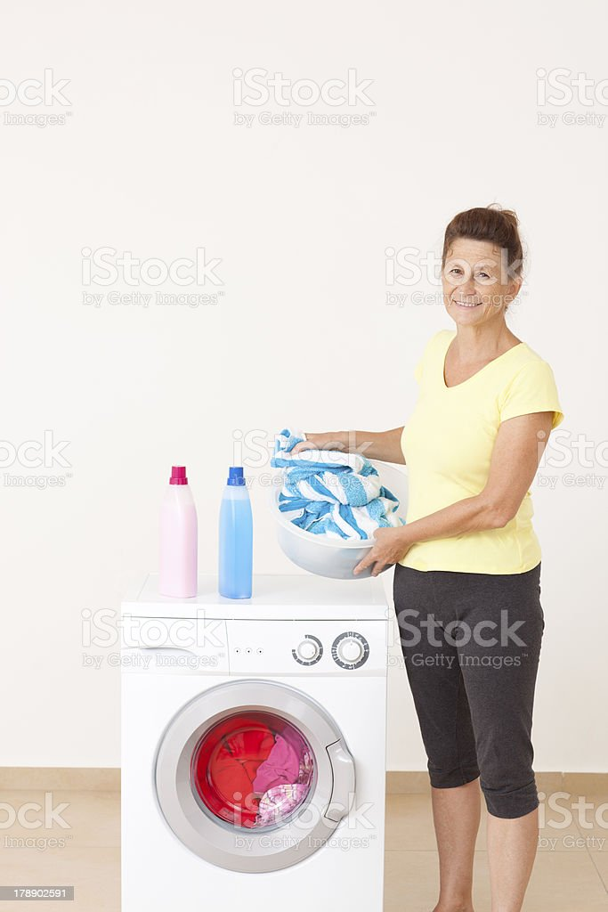 Adult woman doing laundry. royalty-free stock photo