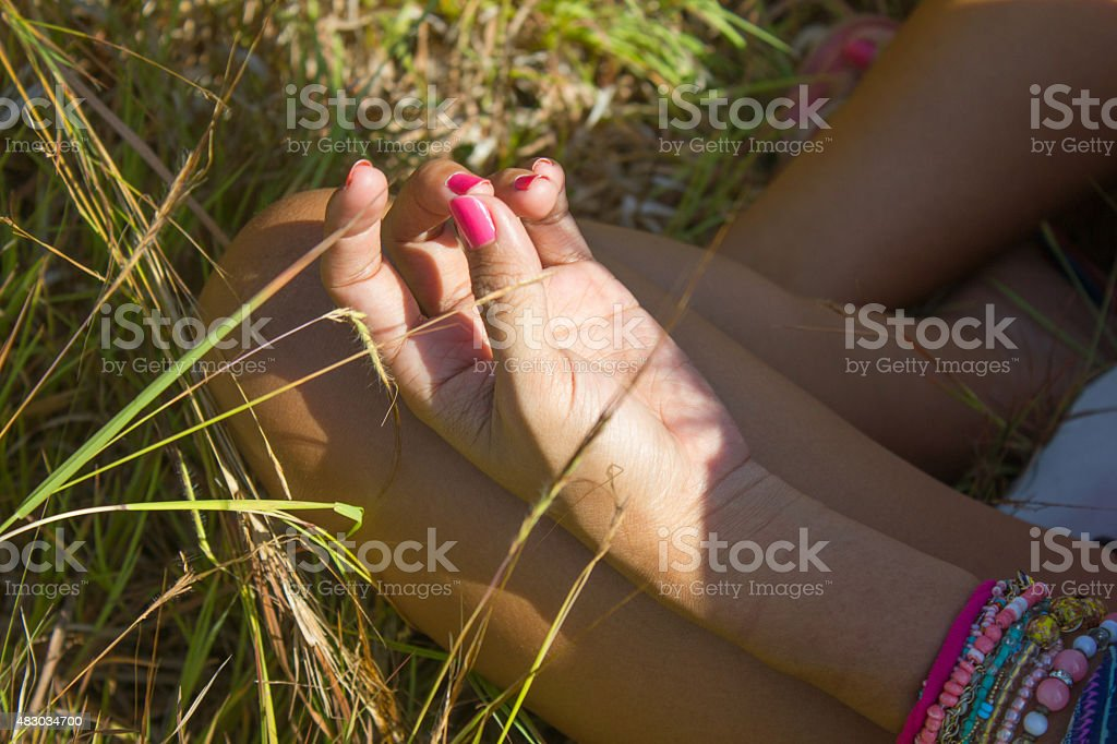 Adult woman doing lotus position stock photo