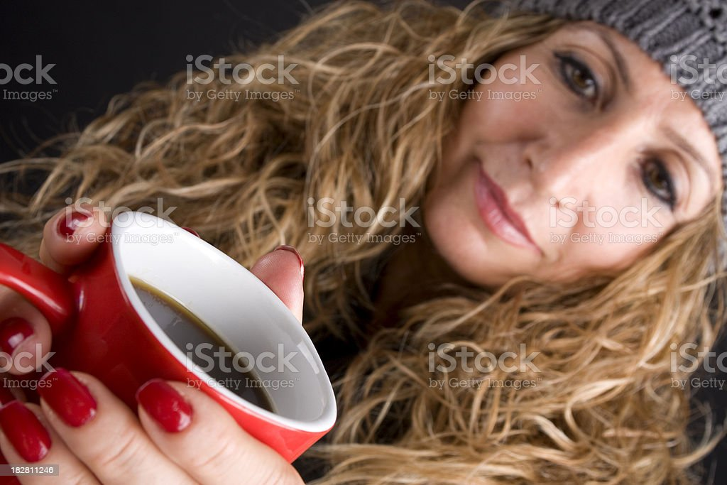 Adult woman drinking coffee royalty-free stock photo