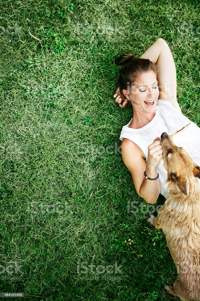 Adult Woman Enjoying Time with Pet Dog stock photo