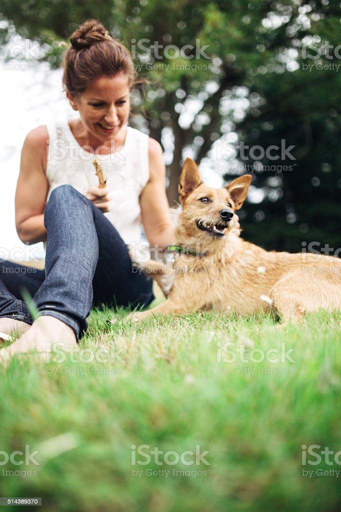 Adult Woman Enjoying Time with Pet Dog stock photo