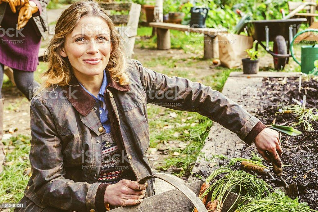 Adult Woman Gardening, Healthy Vegan Lifestyle stock photo