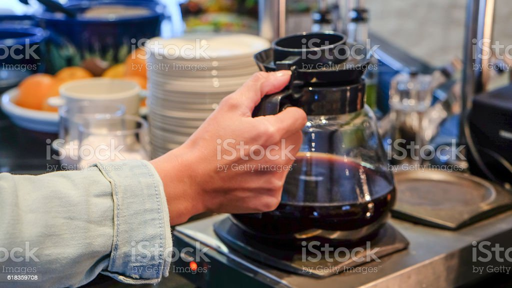 Adult woman holding coffee pot stock photo
