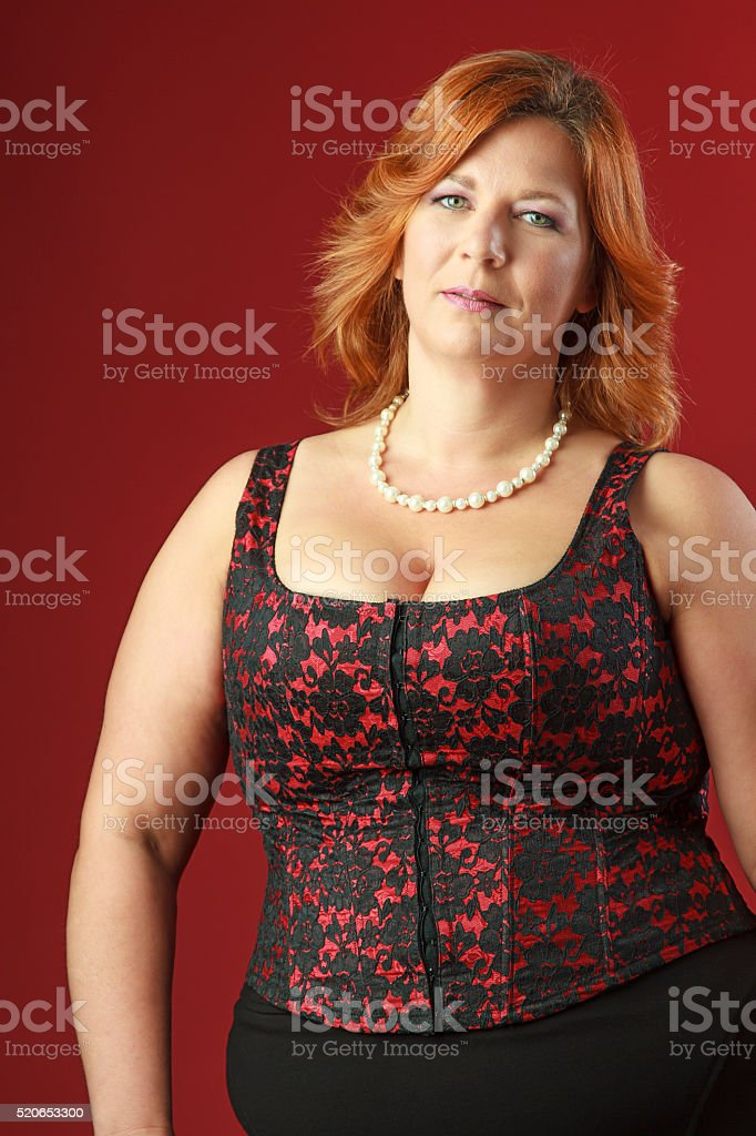 Adult woman in corset stock photo