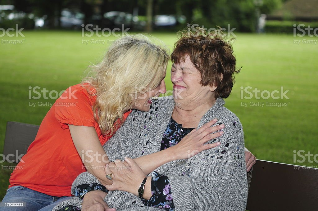 Adult woman is loughing with her mother royalty-free stock photo