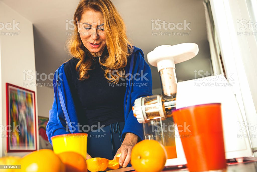 Adult woman juicing after fitness training stock photo