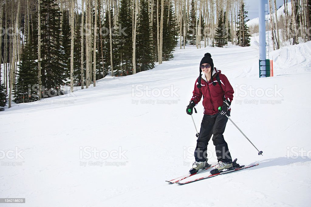 Adult woman learning to Ski stock photo