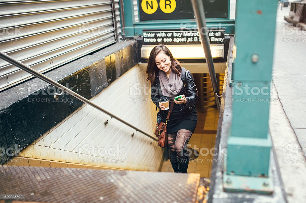 Adult Woman Leaving Subway Station stock photo