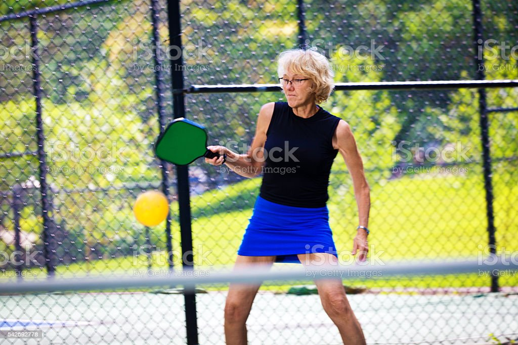 Adult Woman Pickleball Player Playing Pickleball stock photo