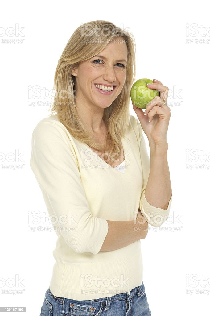 adult woman preparing to consume an apple royalty-free stock photo