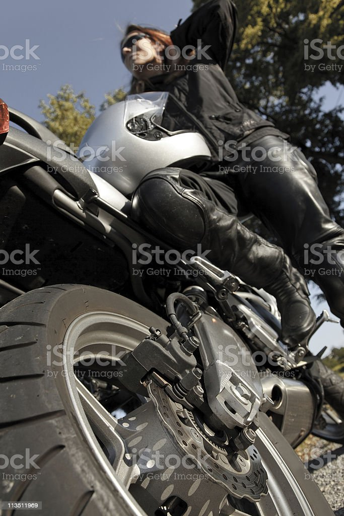 adult woman riding her motorcycle stock photo