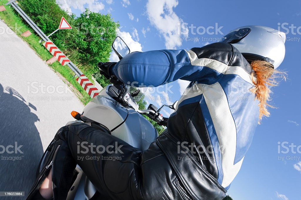 adult woman riding her motorcycle royalty-free stock photo