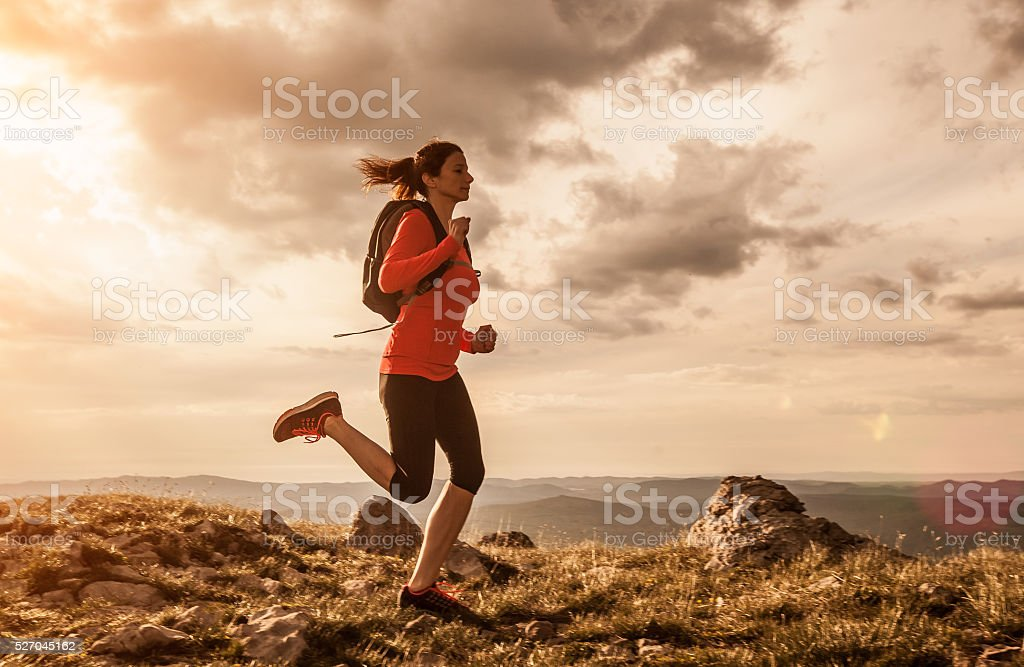 Adult woman running outdoor stock photo