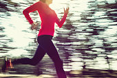 Adult woman running outdoors concept