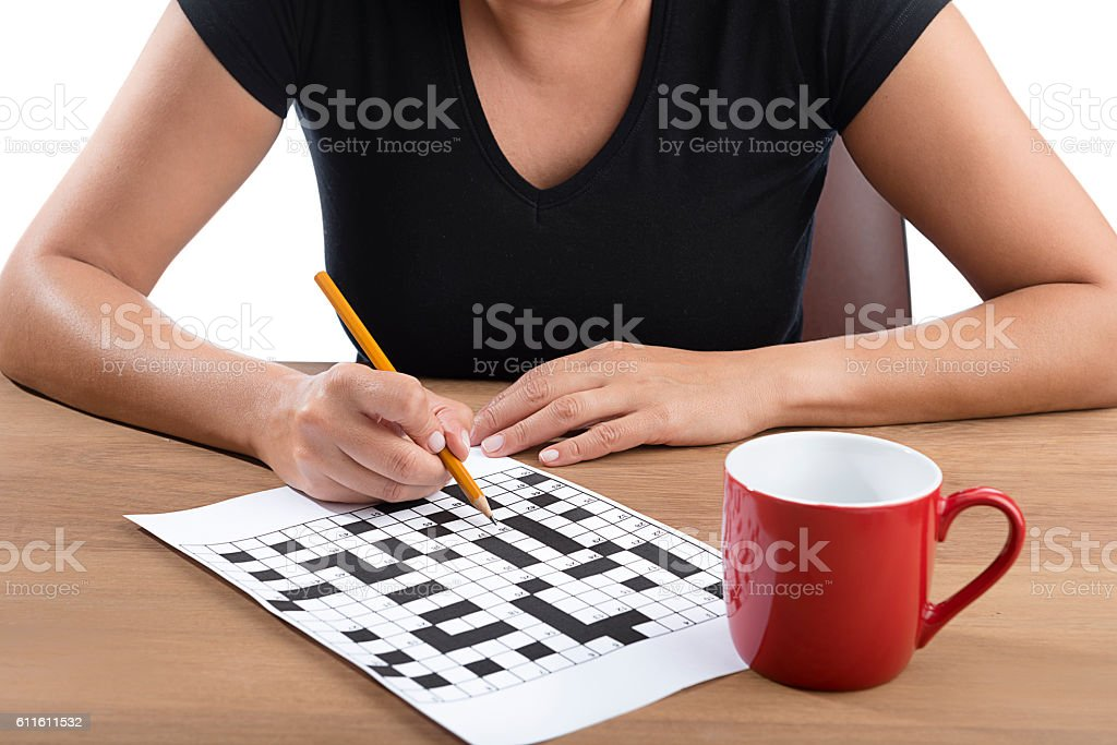 Adult Woman Solving Puzzle stock photo