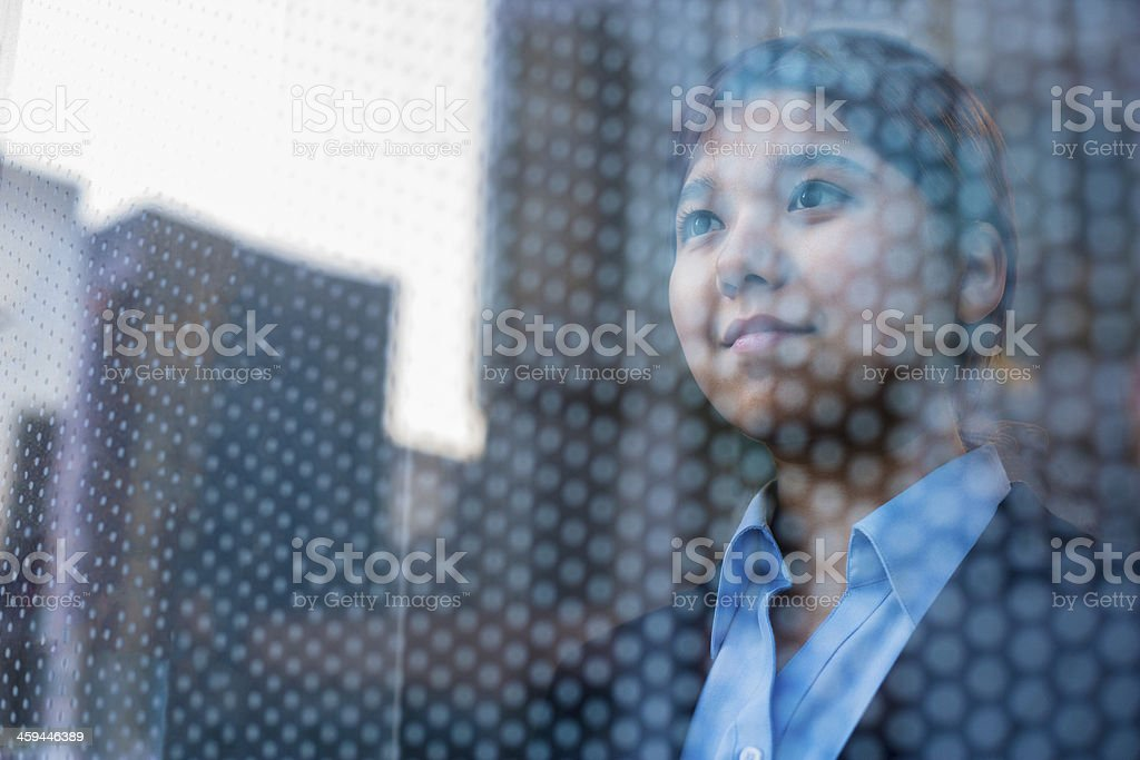 Adult woman staring at the view through the window stock photo