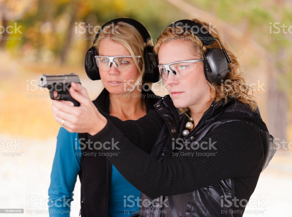 Adult Women at the Shooting Range stock photo