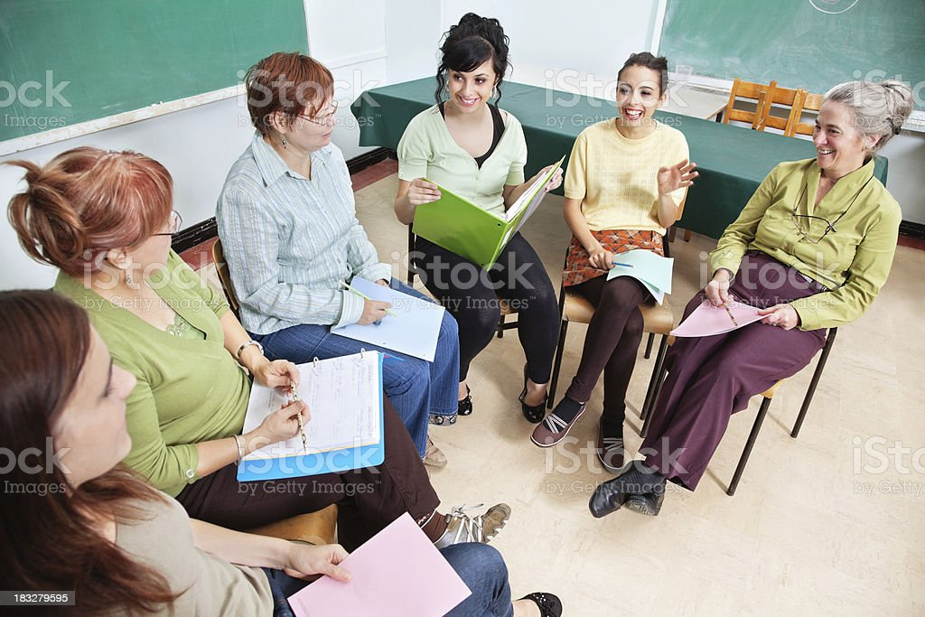 Adult women sitting on chairs in classroom royalty-free stock photo