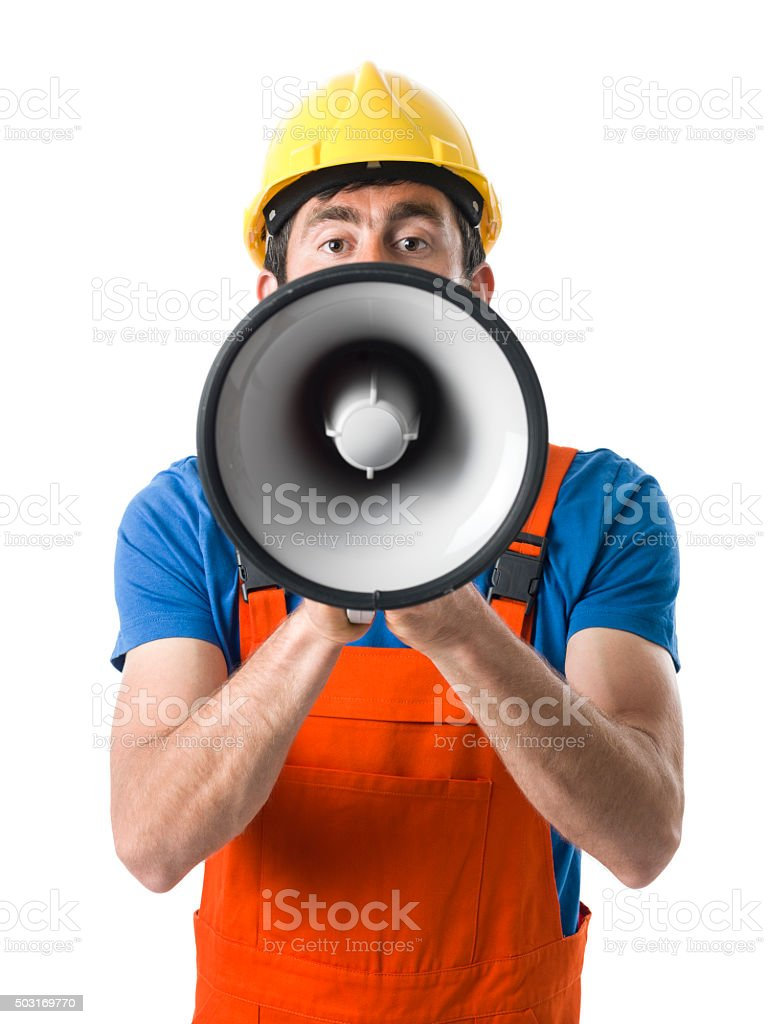 Adult Worker With Hardhat Shouting On Megaphone For Strike stock photo