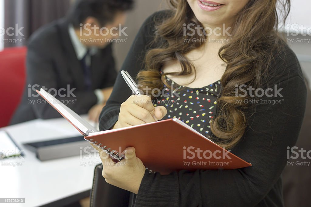 Adult young pretty business woman working at her office. royalty-free stock photo