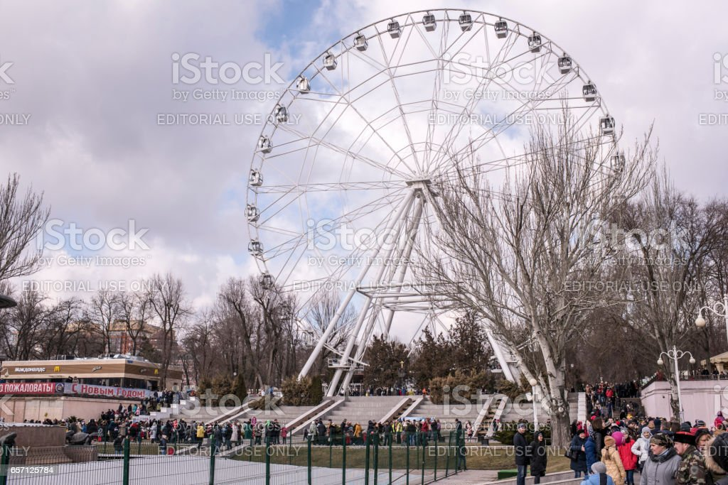 Adults and children walk in the park to Shrovetide stock photo