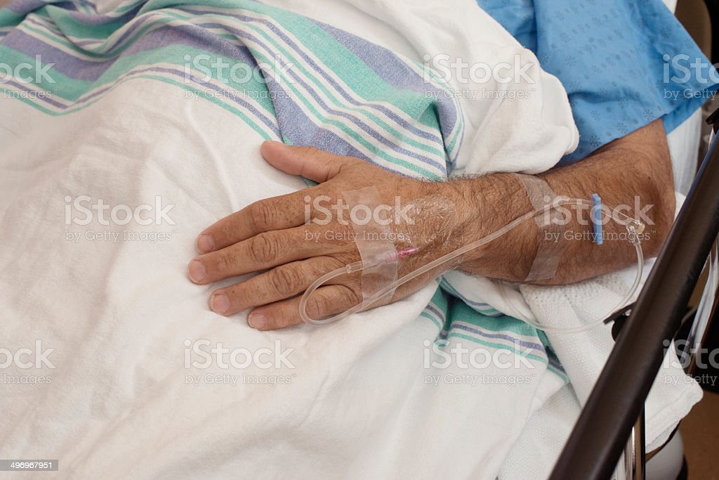 Adult's arm in hospital stock photo