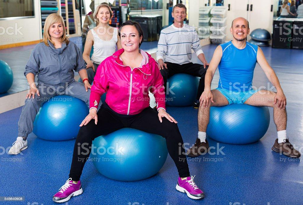 Adults doing aerobics with balls stock photo