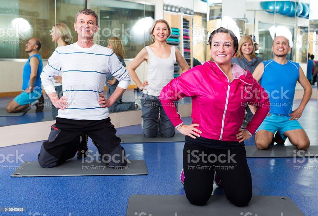 Adults doing pilates routine stock photo