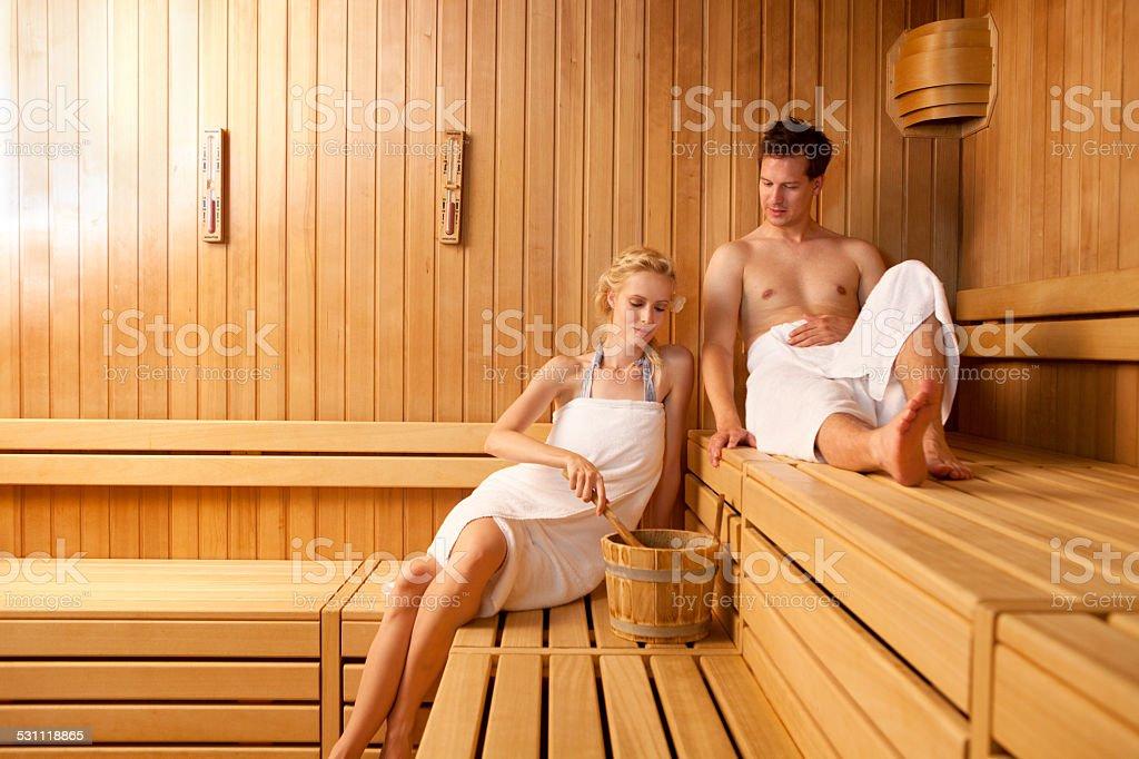 adults enjoying sauna stock photo
