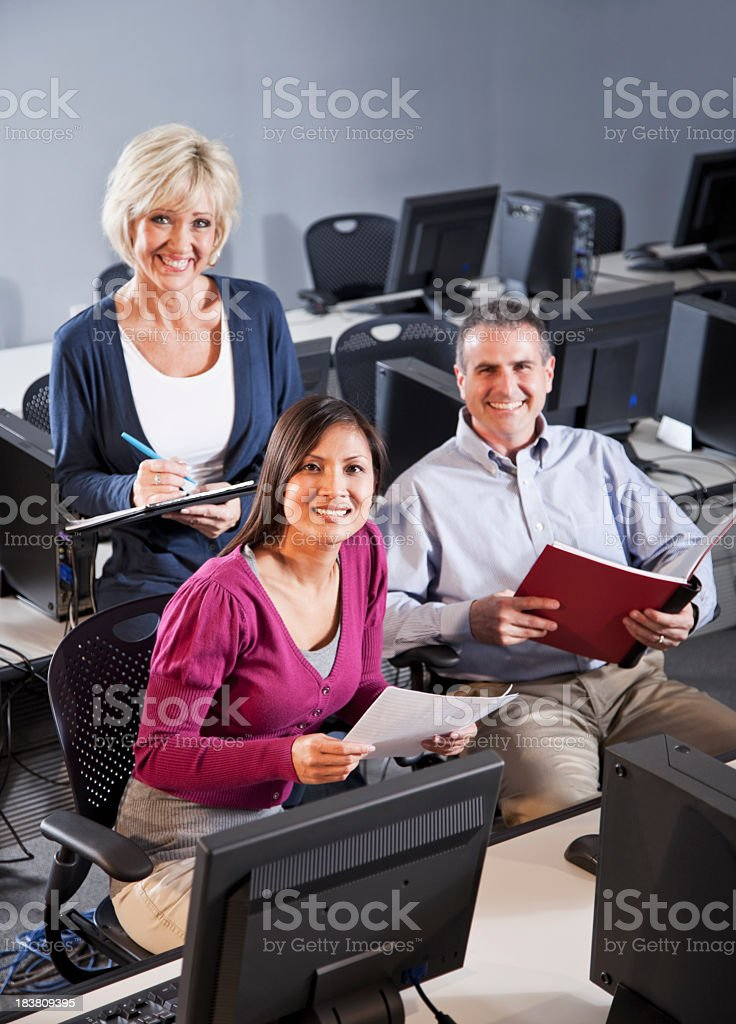 Adults in computer lab royalty-free stock photo