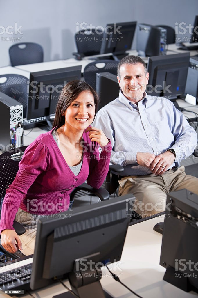 Adults in computer lab stock photo