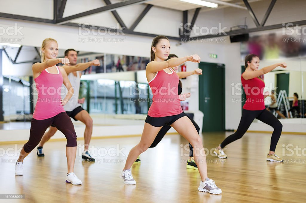 Adults participating in a fitness class at the gym stock photo