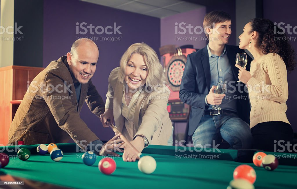 Adults people having pool game stock photo