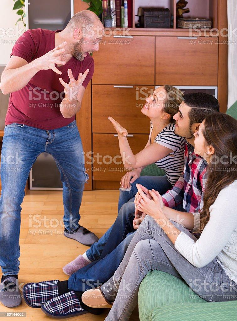 adults playing charades stock photo