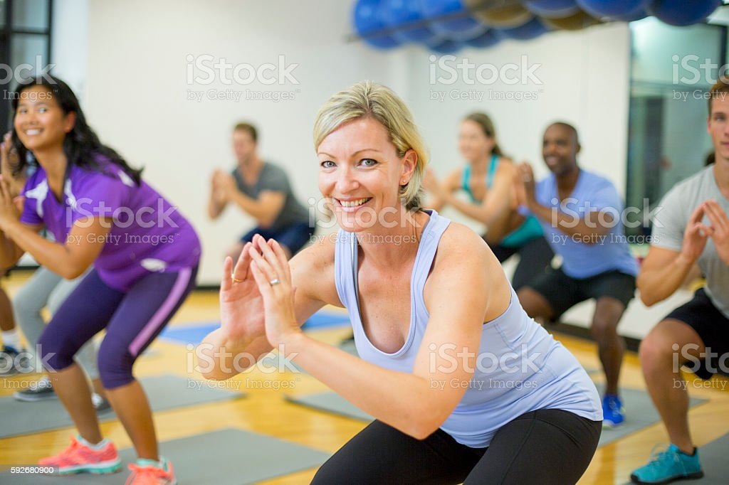 Adults Taking a Fitness Class at the Gym stock photo