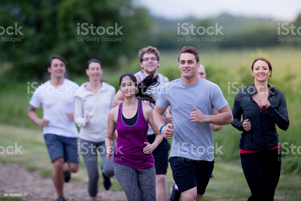 Adults Training Together on a Run stock photo