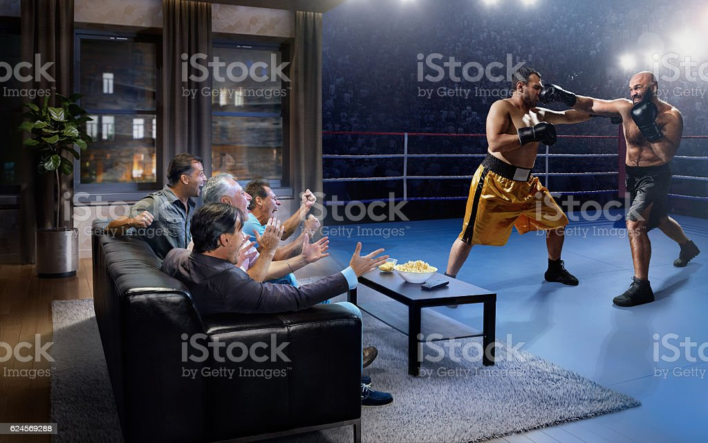 Adults watching Boxing at home stock photo