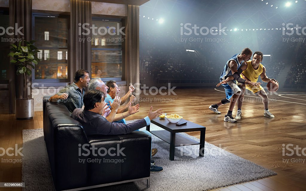 Adults watching very realistic Basketball game at home stock photo